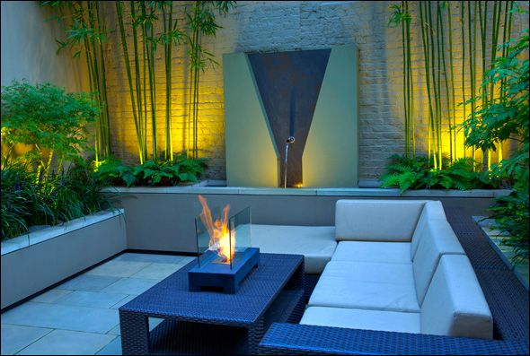 contemporary small courtyard garden design London/ uplighting bamboo
