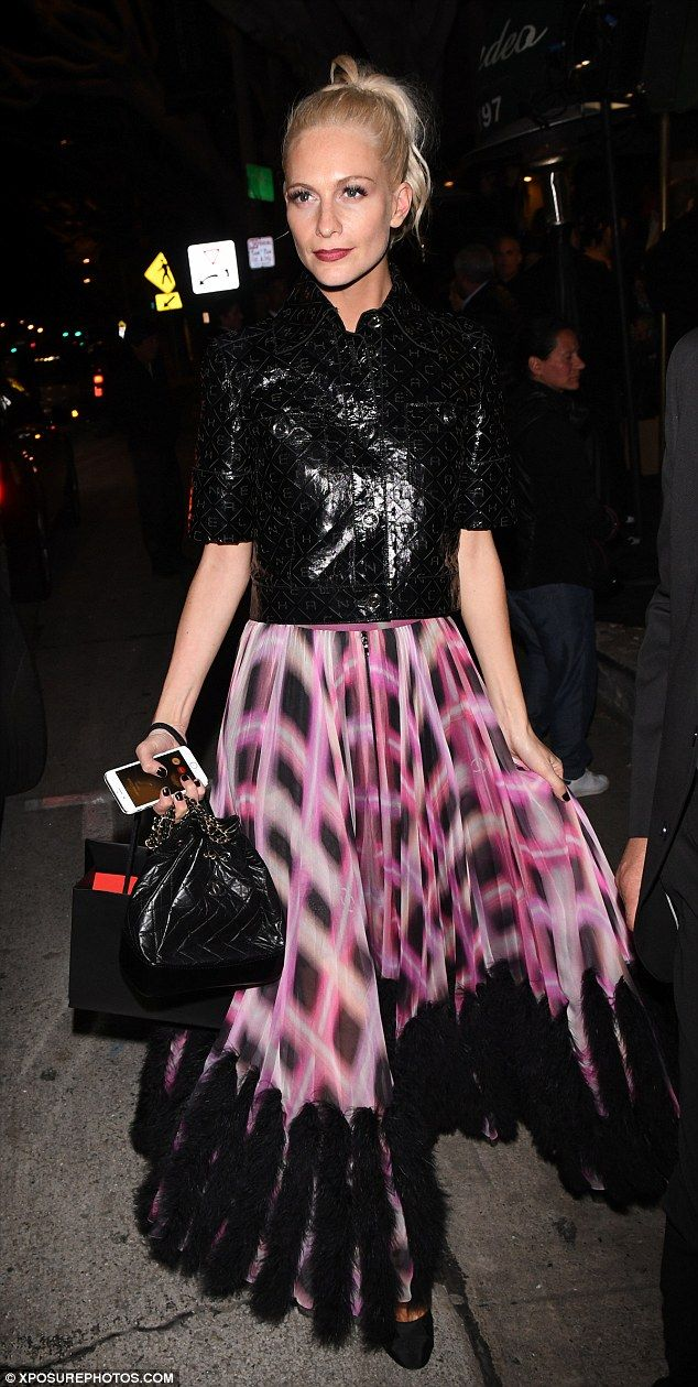 Fashionista: The hem of the distinctive skirt was embellished with black fluffy feathers...