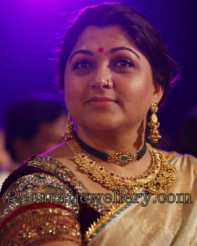 South Indian actress Kushboo in 22 carat gold heavy antique necklace with square shaped ruby's and blue sapphires beads string kundan pen...