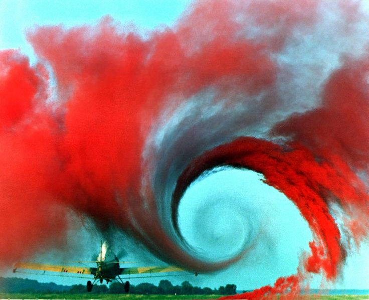 Coloured smoke reveals the amazing vortex airflow patterns off the wings of airplanes.