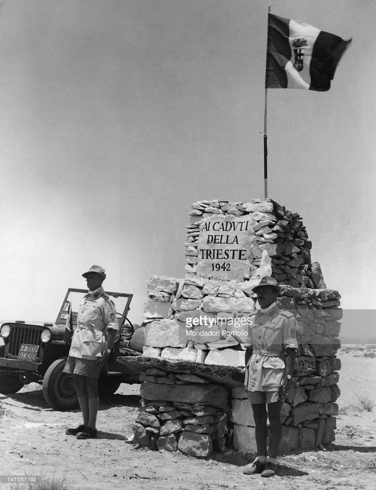 Count Paolo Caccia Dominioni and his assistant Renato Chiodini of the Italian army at the memorial stone, at attention and in silence in honour of those fallen at El Alamein. El Alamein, 21st July 1952