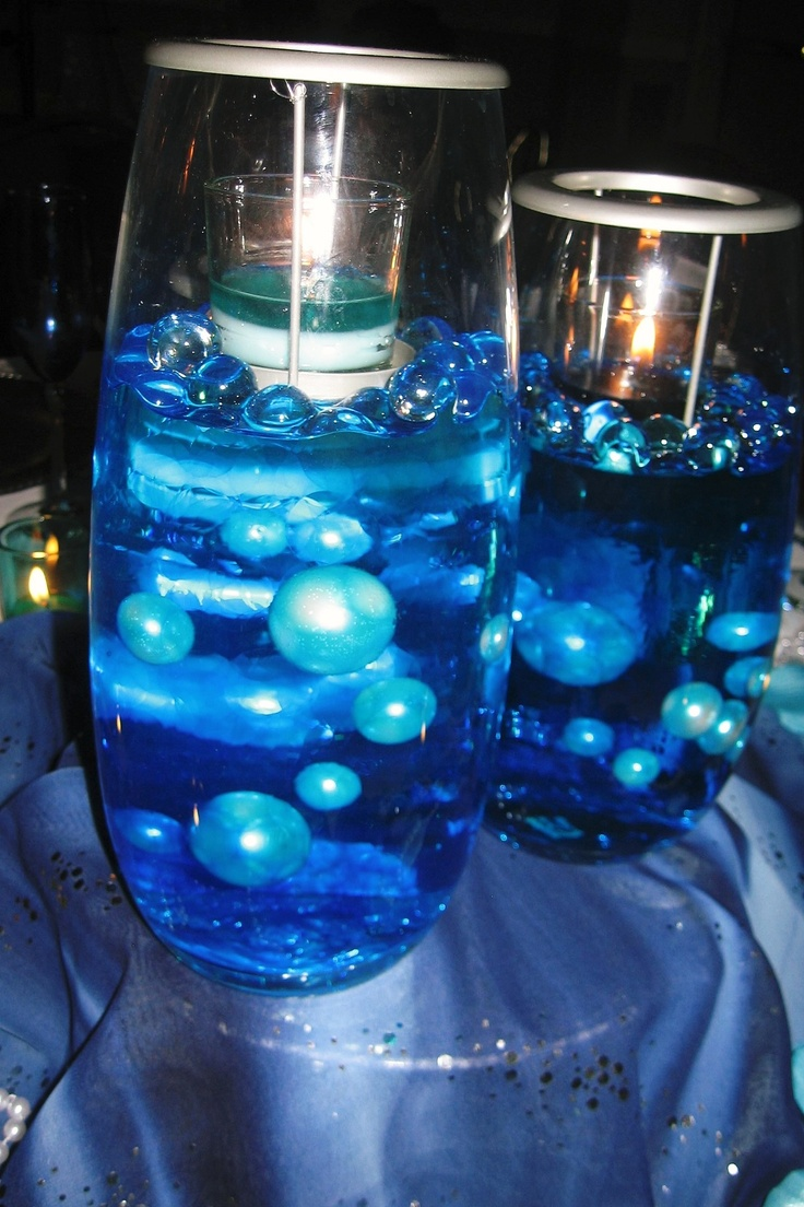 Vaes from Partylite- Clearly Creative Trio set of 3 for $100. Earn it for Free by Hosting a show. www.partylite.biz/candlewares  Large Pearls from factorydirectcraft.com. I used Jell Deco Balls from Hobby Lobby and added Blue food coloring to the water. The vase set on a plant stand I got at Family Dollar for 4.00 and under neath I put 3 Fulcrum Light It 9 LED Anywhere Light X for $19.54.This is from my sisters Shades of Blue 30th Anniversary head table...breath taking beautiful.