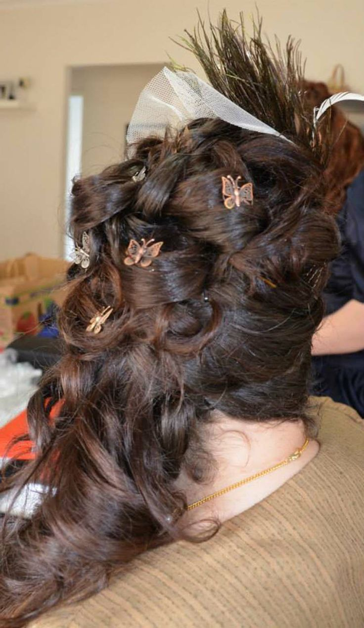 Wedding hair modelled on an 1880s style. Metal filigree butterflies as accents.
