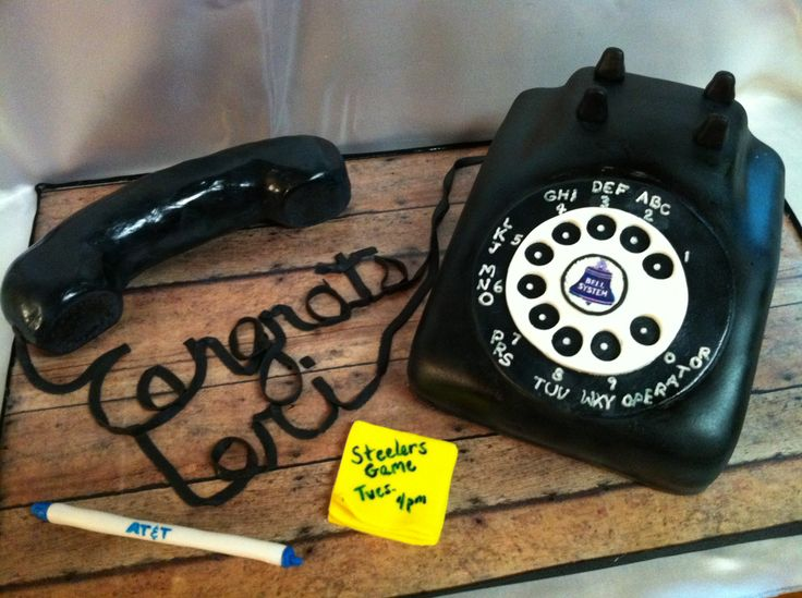 Old Style Telephone - Cake was made for a former co worker of mine who retired from AT&T. Covered in MMF and airbrushed black. The handset was rice krispie treats covered in chocolate then fondant and airbrushed also. I would color the fondant grey next time before I attempt to airbrush because it took alot of coats! My 2nd phone cake!