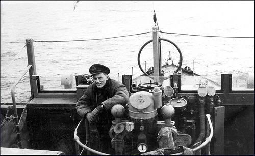 HMCS Wetaskiwin K175. The bridge and one of the ship's officers of HMCS Wetaskiwin K175 circa 1943.