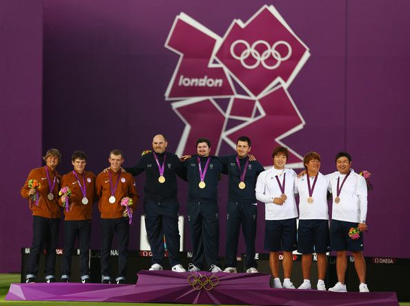 (L-R) Silver medalists Brady Ellison, Jake Kaminski and Jacob Wukie of the United States, gold medalists Michele Frangilli, Marco Galiazzo and Mauro Nespoli of Italy and bronze medalists Bubmin Kim, Donghyun Im and Jinhyek Oh of Korea stand on the podium during the medal ceremony after the Men's Team Archery Final between the United States and Italy on Day 1 of the London 2012 Olympic Games at Lord's Cricket Ground on July 28, 2012 in London, England.