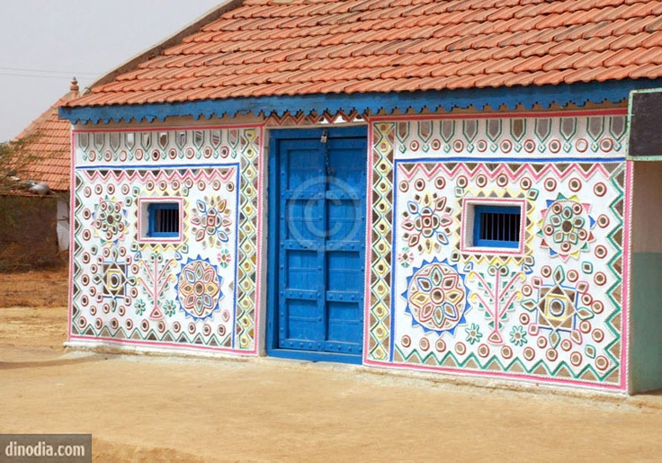 Kutchi mural work with mirror pieces on wall ; Kutch ; Gujarat ; India