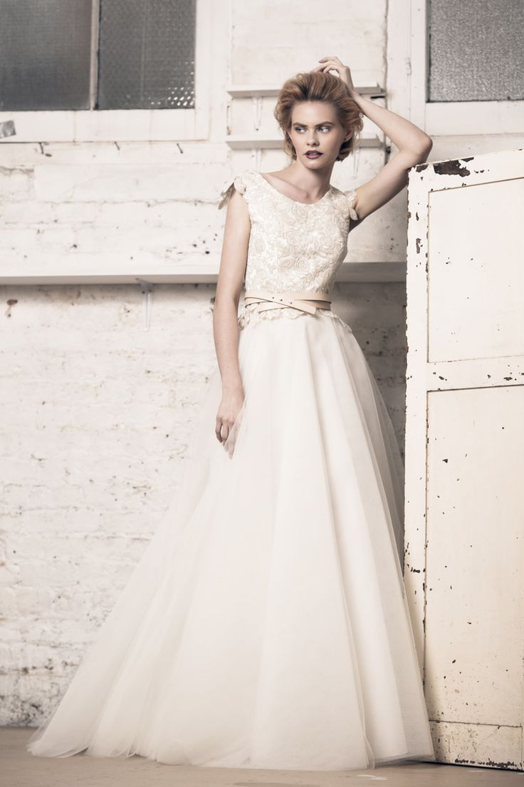 Modern wedding dress for the contemporary bride. Helen top, Felicity skirt. Corded lace top with applique cap sleeves and mini peplum. Tulle ball skirt.