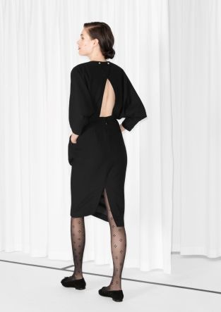 Elegantly draping in all the right places, this open-back dress has a voluminous shape on the top and bottom - a fitted waist gives the silhouette an ultra feminine twist.