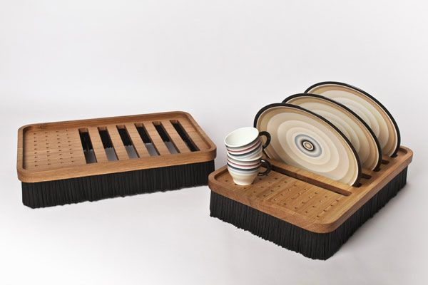 A tablet shape dish-rack which helps you display your plates. Composed by a durmast top where to dry plates and glasses, the object is maintained in suspension by a perimeter of natural bristles which, if necessary dries out the excessive water on the counter. www.studiolievito.com