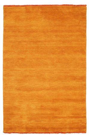 Handloom fringes - oransje teppe 120x180