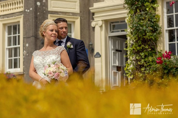 Bride and Groom outside their New House Hotel Cardiff wedding venue.