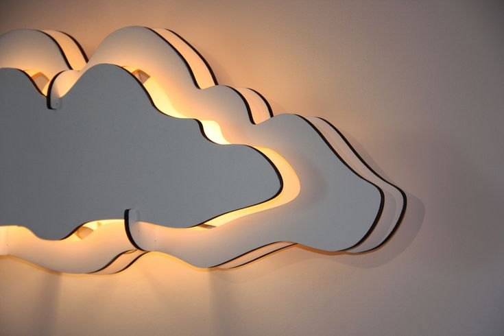 CLOUD wall lamp consists of Poplar wool slices which are cut using Computer Numerically Controlled (CNC) laser technology. The modular standardized tw