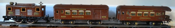 Prewar Ives Standard Gauge Set No. 691R   C.1926-27 Features brown 3235R engine with matching 184 club car and 186 observation car Engine is fully operational and features die cast wheels, brass plates, electric reverse and operating headlight. cars are illuminated. Set is all original Grades to C-7  Contact info@conceptshopnyc.com for inquiries about purchasing this set.