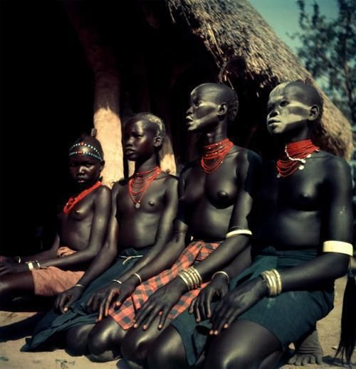 George Rodger. SUDAN. Kordofan. The Nubas. Dinka and Nuer girls dressed for ceremonial dance. 1949.: