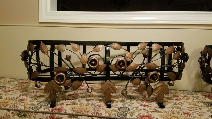 Cleaned with wire brush. Used Rustoleum Rust Reformer in black over whole piece, then handpainted the leaves and flowers with Rustoleum hammered copper paint.  Finally coated with Rustoleum clear coat.