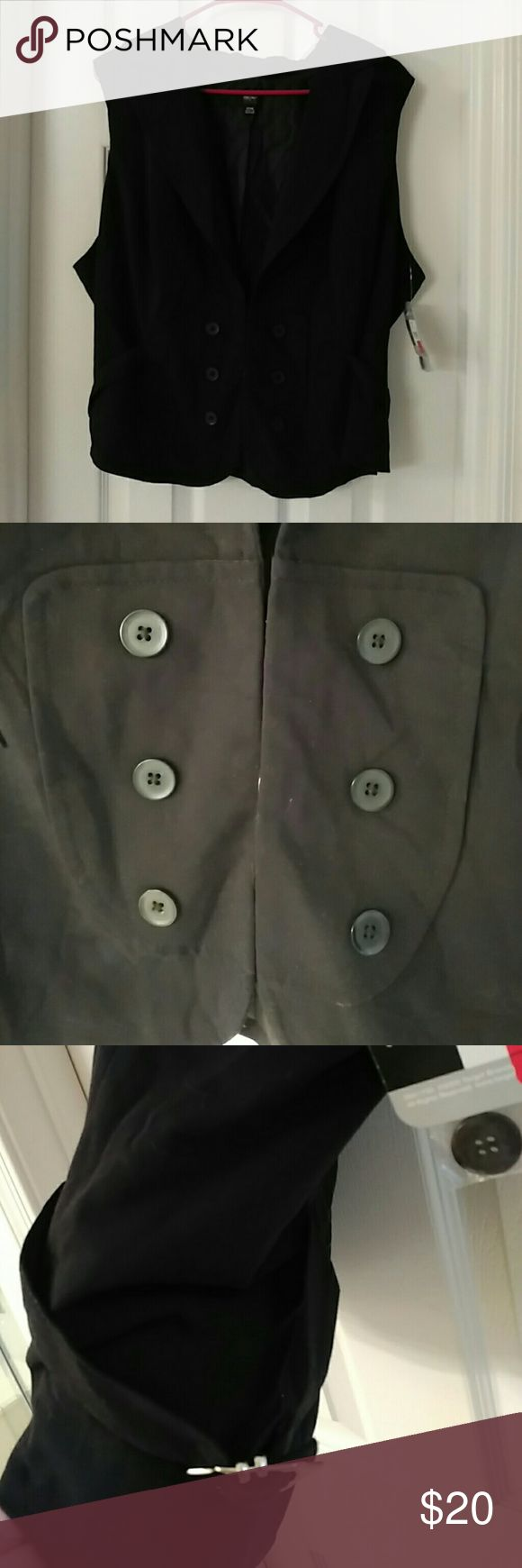Nwt plus size 2X size 20 black front hook vest NWT beautiful mossimo plus size polyester vest faux buttons front  hooks down the front has side buckle ties for detail + synching beautiful low cut all black w silver buckle attached buttons n tags spare buttons perfect condition brand new size 2X tagged 20 made in Philippines   Mossimo stretch polyester rayon blend plus size quality is great   Pit to pit 25 inches flat Vertical back 23 inches flat   Torrid lane Bryant torrid Cato avenue plus…
