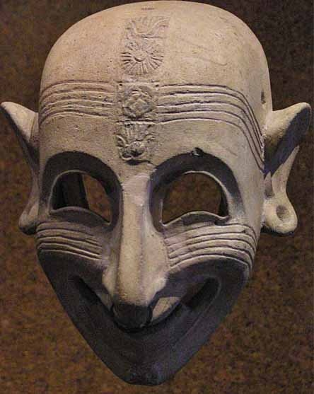 """Phoenician grinning mask (5th century BCE) found in San Sperate, Sardinia, on display at the National Archaeological Museum of Cagliari. It's an example of the """"sardanios ghelos"""", the sardonic laugh mentioned by Homer and others in ancient times."""