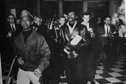 Lil' Bobby Hutton and Bobby Seale inside the Sacramento Capitol building protesting the Mulford Act, a new law to stop the Black Panther Party from legally doing armed patrols of the police (May 2, 1967).