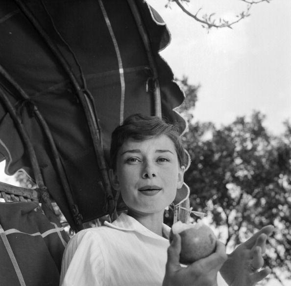 Rare Audrey Hepburn — Audrey Hepburn eating an apple on the terrace of...