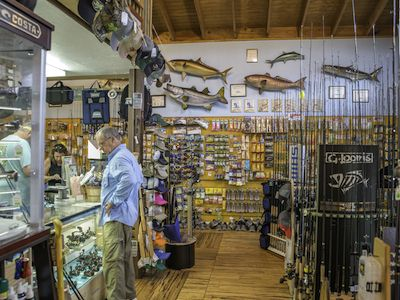 MustDo.com | Full-service bait and tackle shop offering a massive selection of fishing gear including rods, reels, tackle, live and frozen bait, fly and spinning gear. Whitney's Bait and Tackle Sanibel Island, Florida.
