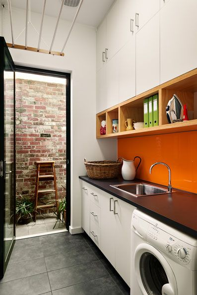 21_8-natural-light-terrace-passive-solar-architecture-sustainable-architect-melbourne-garden-views-clothes-rack-retrofit-insulation-plywood-joinery-laundry.jpg