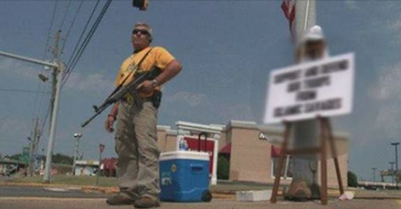 Armed Man Holds Brutal Sign, Muslims Call FBI Because They Are 'Offended