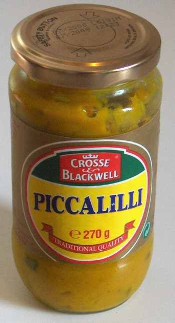 Maak een pot piccalilly lekker pittig door er een Madam Jeannette peper heel fijn gesneden door te roeren.