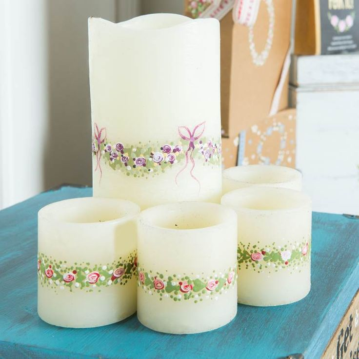Our You Can Folk It designs can be painted onto candles. Just add Paint adhesion medium to your paint (1:1) and start decorating. Kits and Paint adhesion medium are all available at www.folkit.co