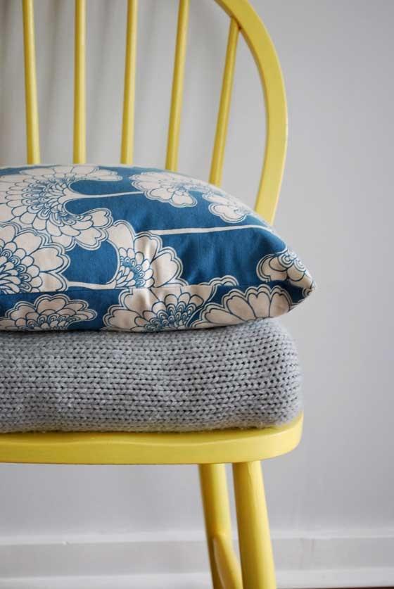 "Yellow, grey and blue - bedroom. Grey sheets ""50 shades of grey"" ha ha. Blue duvet. Buttercup yellow throw pillow."