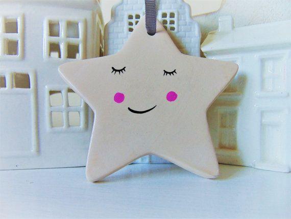 Star ornament by Vivi Lake. Https://www.etsy.com/uk/listing/497554537/hand-painted-ceramic-porcelain-star