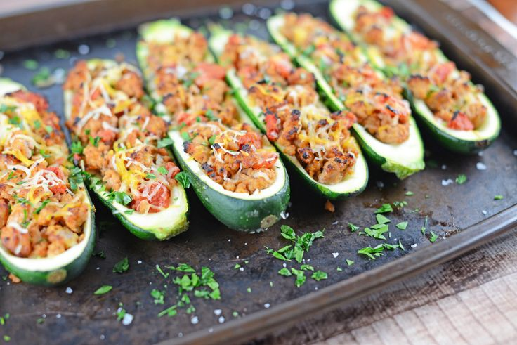 You should make Grilled Turkey Zucchini Boats because they are fresh, healthy and super easy! I don't know about you, but I'm getting a little bored with the usual grilling options and looking for quick and healthy alternatives. My husband has fond memories of his grandmother serving up ginormous stuffed zucchini in the summer months....