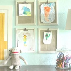 Use and old 8x10 frame, fill it with fabric, glue a clip and you have an attractive way to display children's artwork.