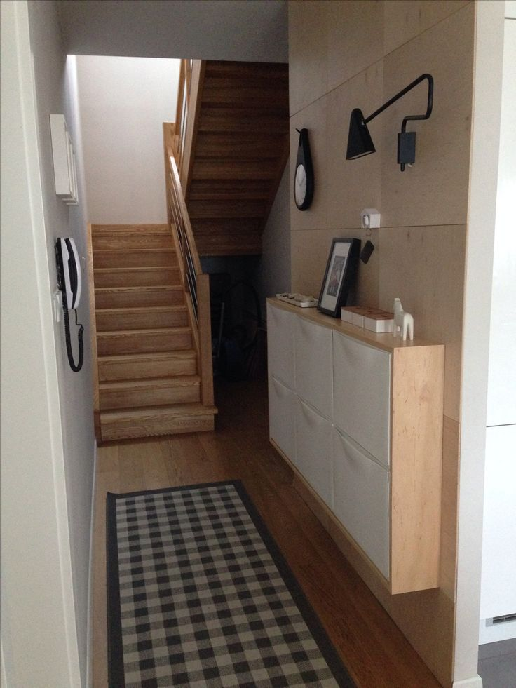 Plywood wall and IKEA TRONES cabinets in my hallway. - I like this staircase, too.