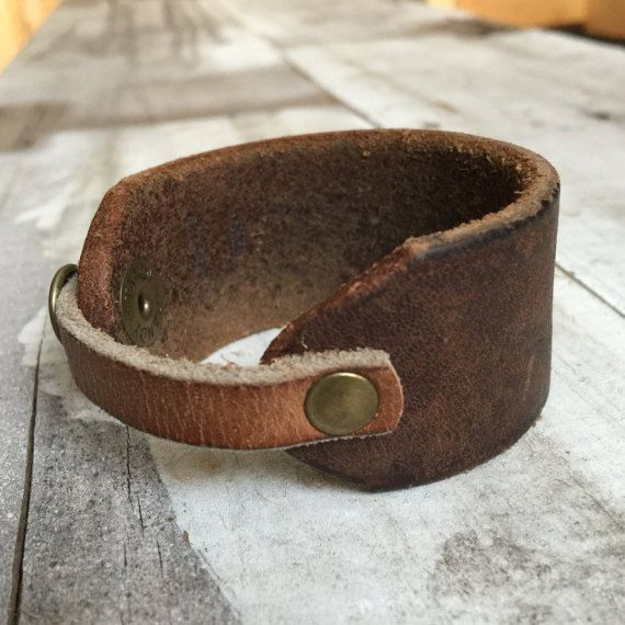 Handcrafted two-toned leather cuff bracelet with brass rivets and snap. 7 1/2 length x 1 1/4 width. Something for everyday! Check out more creations at Orange and Prairie at https://www.etsy.com/ca/shop/orangeandprairie