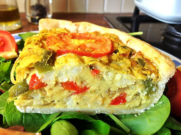 "The Gourmet Vegan ""Can't tell the difference"" Quiche Recipe Lunch and Snacks, Main Dishes with shortcrust pastry, cauliflower, oil, salt, onions, red bell pepper, green bell pepper, slice, chickpea flour, water, vegetable stock, sage, tumeric, nutritional yeast, black salt, sea salt, tomatoes, vegan margarine"