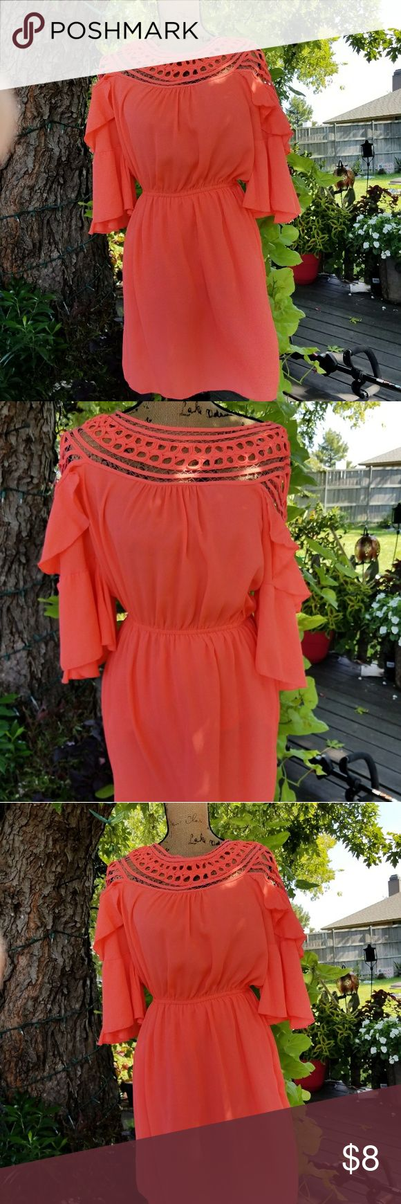 Bright Orange Dress Bright, bold, and beautiful. With the dirty cutouts on the shoulders. Eye catching. One small strick pulled through on one if the pictures. Easily fixable. Priced accordingly Dresses Midi