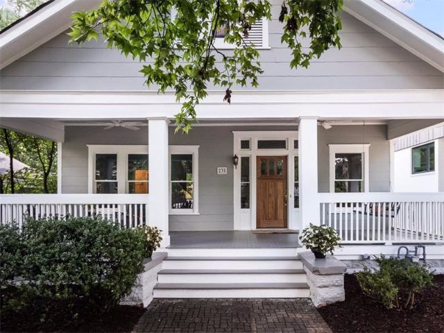 See how the elegant porch of this 1920s Craftsman pales in comparison with its bright dining room