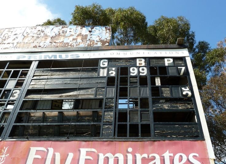 Photo of number ninety-nine (99). The old scoreboard at Victoria Park, Collingwood, Melbourne, Australia. It has since been demolished. What tales this board could have told! From nail-biting football games to homeless men sheltering in its detritus.