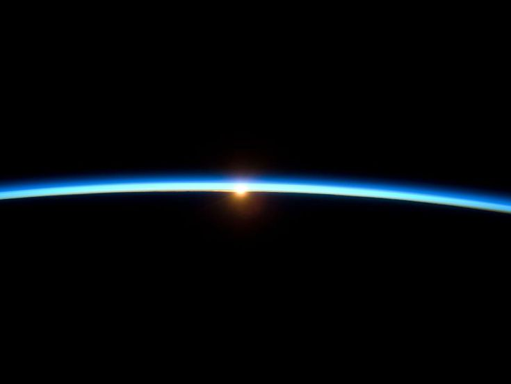 An achingly beautiful photo of the Earth and the setting sun from the International Space Station ... shows the thin blue line of our fragile atmosphere!