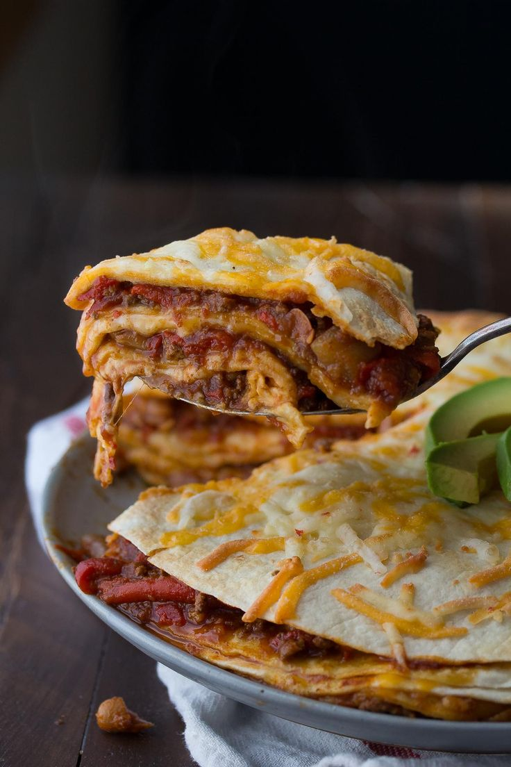 A SIMPLE and easy tortilla stack recipe to use up chili leftovers: spread between stacked tortillas with shredded cheese, and baked up!
