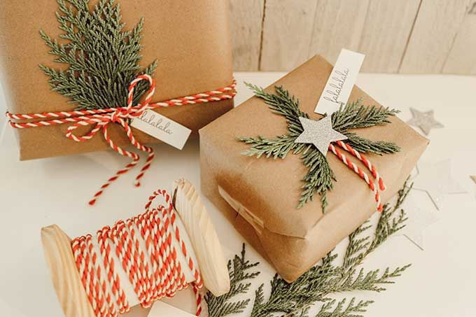 Natural Holiday Gift Wrap With Greenery Hallstrom Home Simple Gift Wrapping Holiday Gift Wrap Christmas Tree Wrapping Paper