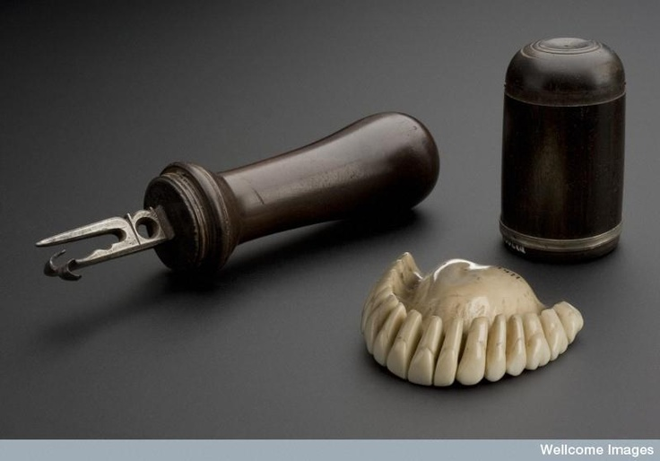 18th century tool to carve marks in  dentures. Both tool and dentures made of hippopotamus ivory