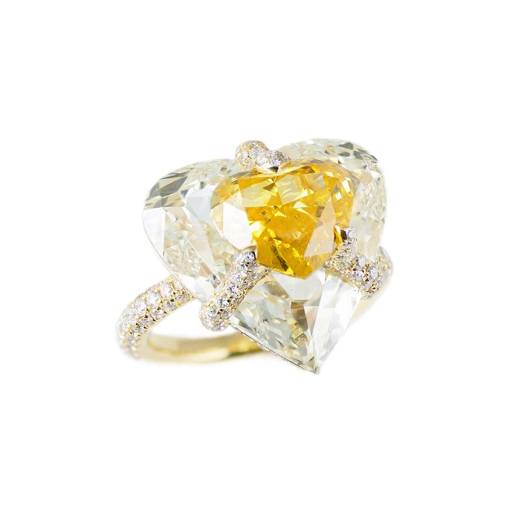 Boghossian Kissing Diamonds yellow diamond ring with white diamonds set in yellow gold. http://www.thejewelleryeditor.com/jewellery/article/boghossians-daring-creations-are-perfect-reason-visit-masterpiece/ #jewelry