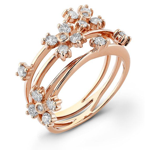 14k rose Floral Diamond Ring      This 14kt rose gold ring has a classy design to it. It contains eighteen diamonds with a total weight of .62ct.
