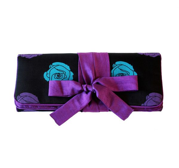 Keep your knickers organised on holiday with this hand-woven 100% silk lingerie case. Dual padded compartments allow you to separate bras/underwear or fresh/wor