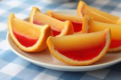 JellO-Shots....... Cut an Orange (or lemon or lime) in HALF and gut it. Mix the jello shot (1 cup hot water, box jello, 1 cup various liquors), stir till disolved, then add the jello mix to the half shell and refrig for 3 hours or more. Once solid, slice and serve!