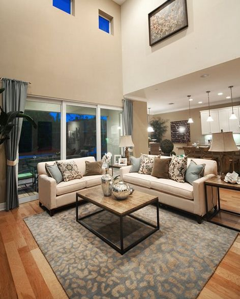 High ceilings and great home decor is highlighted in this living room in  our Copperleaf Community110 best Sophisticated Living Rooms images on Pinterest   Pulte  . Model Home Living Room Pictures. Home Design Ideas