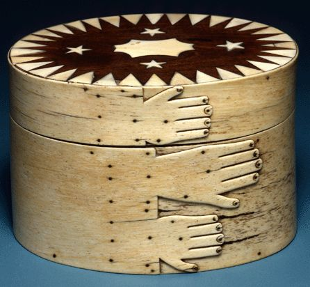 This box from the New Bedford Whaling Museum's outstanding scrimshaw collection was made between 1840 and 1856 of whale bone and ivory, mahogany, wood and tortoiseshell.