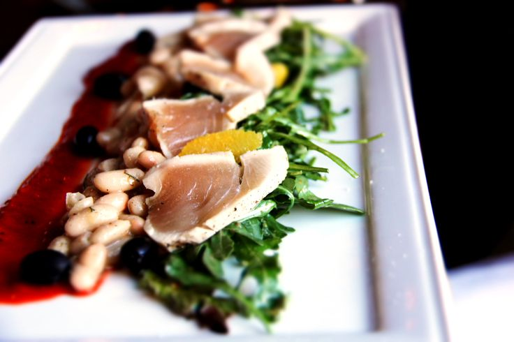 Seared Albacore Tuna, cannellini beans, arugula, nicoise olives, piquillo vinaigrette